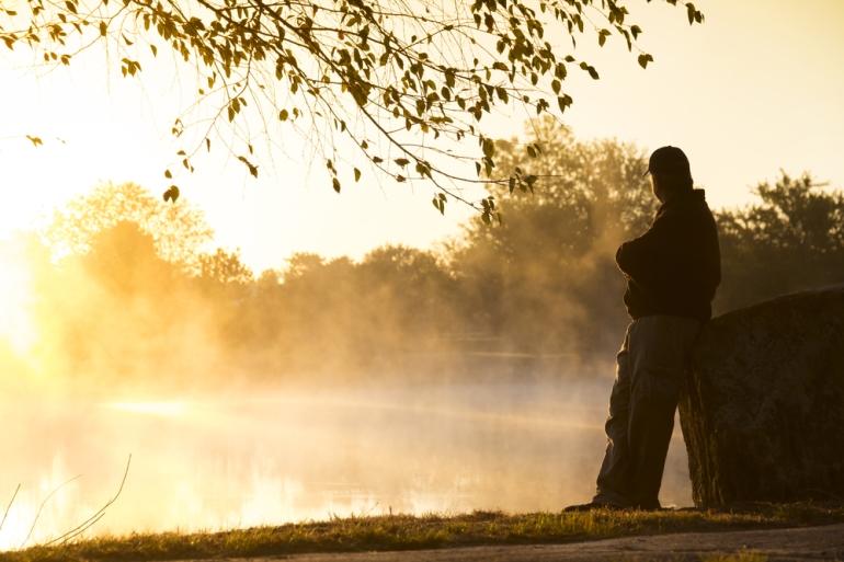 man by foggy lake